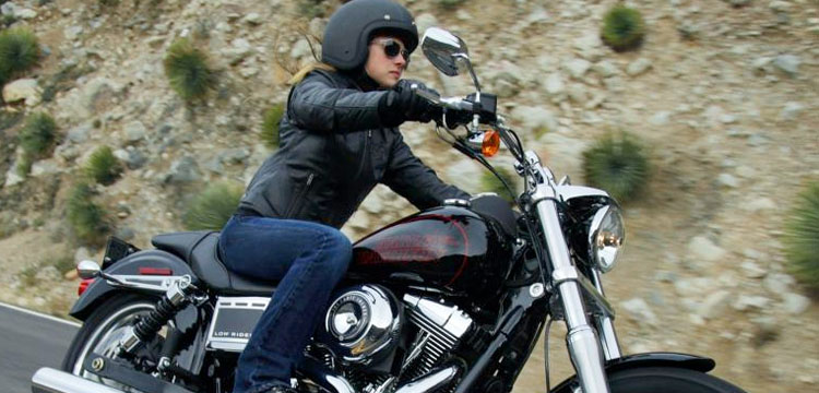 Woman on Harley Dyna Glide motorcycle